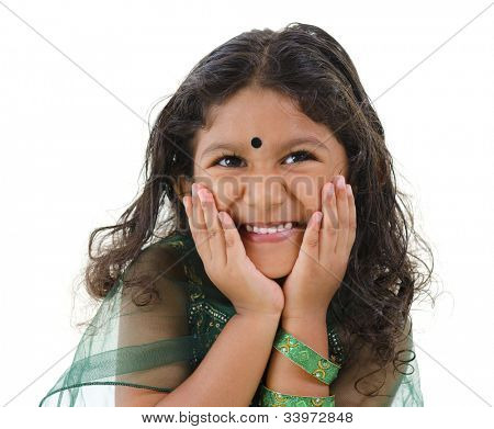 Young little Asian Indian girl smiling on white background