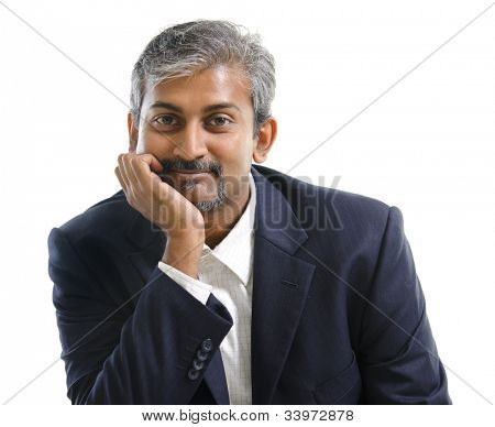 Mature Indian businessman smiling, isolated white background