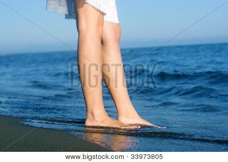 Girl Legs At The Beach
