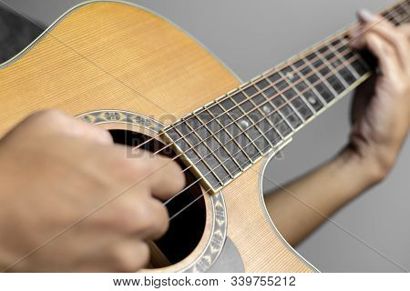 Male Musicians Playing Acoustic Guitar. Closeup Musicians Are Playing Acoustic Guitar. Male Musician