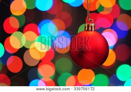 Christmas And New Year's Toys On A Colored Background With Bokeh