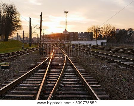 Railway At Sunset. Railway Station Against At Sunset. Industrial Landscape With A Railway. Railway J