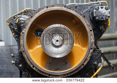 A Side View Of A Yellow Gearbox Taken From A Car Or Tractor In A Vehicle Repair Workshop. Auto Servi