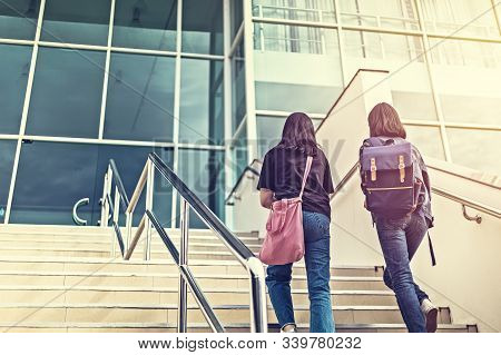 The College Student Walking Up The Staircase