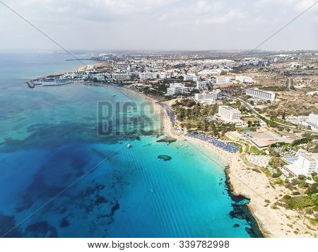 Cyprus Beautiful Coastline, Mediterranean Sea Of Turquoise Color. Houses On Mediterranean Coast. Tou