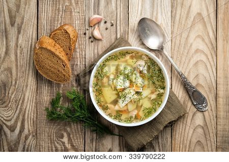 Fresh Homemade Fish Soup With Vegetables In Bowl On Rustic Wooden Background, Top View With Copy Spa