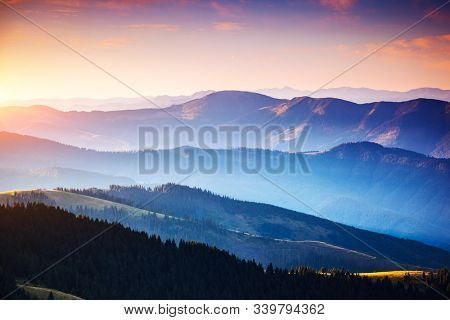 Calm evening landscape in the mountains at sunset. Picture of colorful cloudy sky. Location place of Carpathian national park, Ukraine, Europe. Idyllic natural wallpaper. Discover the beauty of earth.