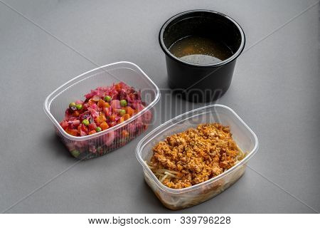 Pasta With Minced Meat And Onion In Navy-style And A Jar Of Vinaigrette On A Gray Background. Food F