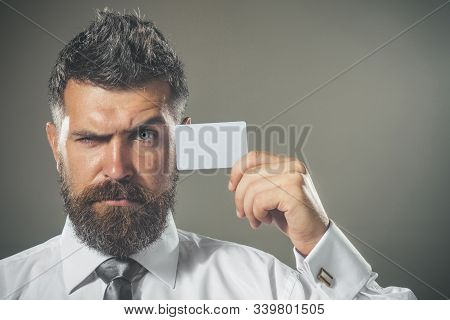 Business Branding. Serious Bearded Man With Blank Business Card In Hand. Businessman Shows Credit Ca