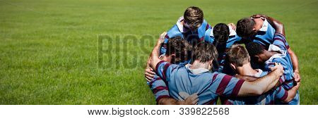 Rugby players against rugby ball on the pitch