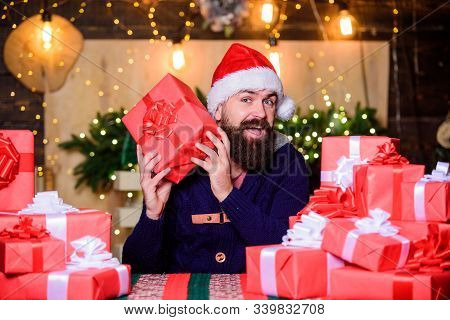 Wrapped Gifts With Ribbons And Bows. Man Bearded Santa Claus Hat Celebrate New Year. Hipster Prepare