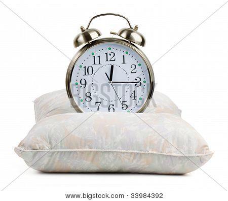 Metal Alarm Clock On A Pillow