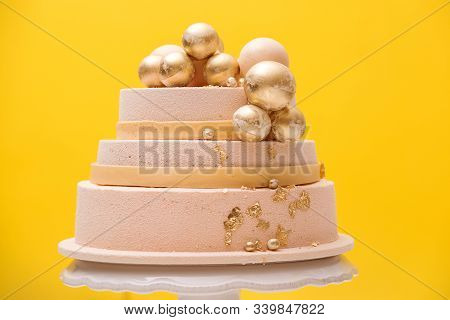 Tiered Birthday Cake Decorated With Golden Balls. Luxury Decorated Cake For Wedding Or Anniversary O