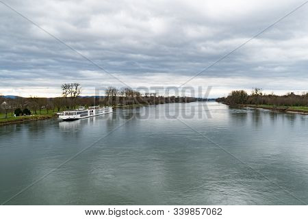 A View Of The Rhine River And An Anchored River Cruise Ship Near Strasbourg