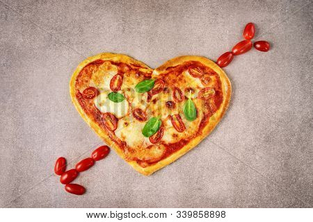 Delicious Heart Shaped Italian Pizza On Brown Background
