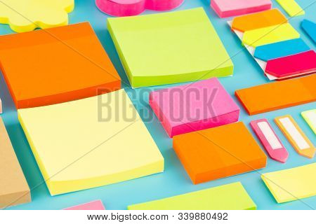 The Collection Of Colorful Paper Stickers On Blue Background.