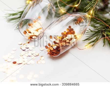 Transparent Wine Glasses With Golden Spangles. Festive Background With Crockery.