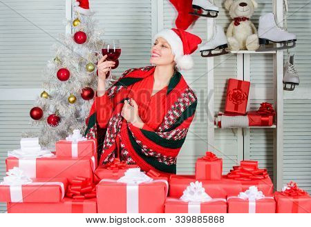 Christmas Toast. Woman With Wine Glass Celebrating Winter Holiday Christmas. Christmas Eve Concept.