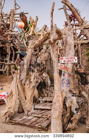 Ko Phayam, Thailand - February 19, 2019: Entrance to the famous Hippie Bar made from driftwood on Ko Phayam island