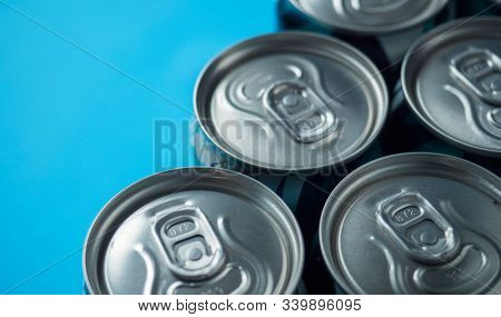 Aluminum beer cans on a blue background