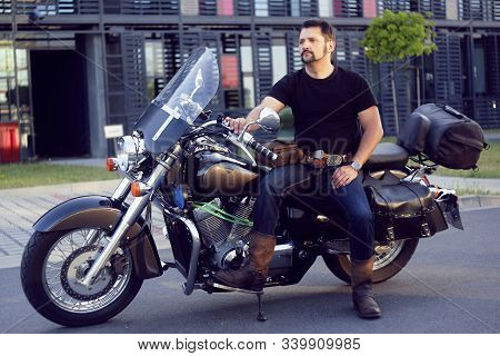 A Man On A Motorcycle Near The Office. Man On A Motorcycle Takes His Girlfriend From Work. Biker Cam