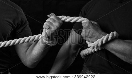 Tug Of War. The Concept Of Strength And Struggle. Two Men Are Fighting For Leadership In Tug Of War.