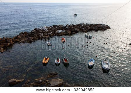 Inflatable Boats In Riomaggiore Harbor With Breakwater