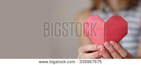 Caucasian Woman Holding Paper Folded Origami Red Heart. Insurance, Charity Donation Concept. Text Ar