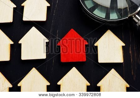 Property Valuation And House Hunting. Home Models And Magnifying Glass.