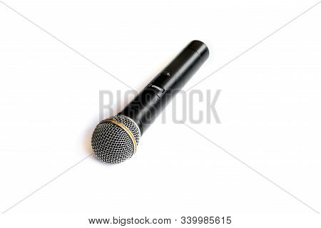 Black Wireless Microphone  Isolated On White Background.a Microphone Without A Physical Cable Connec