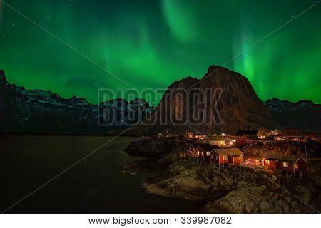 Northern Lights, Aurora Borealis, With Classic View Of Hamnoy, Near Reine On Lofoten Islands, Norway