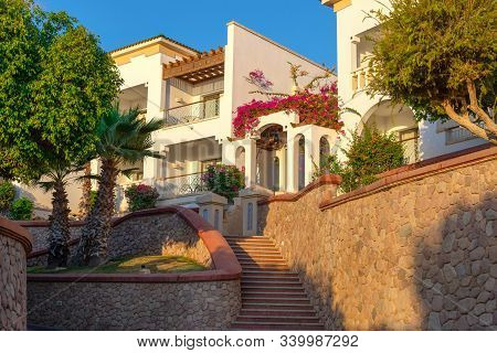 Luxury Mansion In Paradise. Tropical Resort Of High Class. Lush Greenery, Flowers And Sunshine Are P