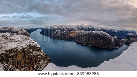 Panoramic View Of The Lysefjord From The Famous Preikestolen Pulpit Rock, Some Snow On The Peaks And