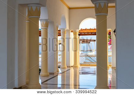 An Open-air Hall With Columns. The Terrace With Columns Is Blown Out By The Sea Breeze. Marble Floor