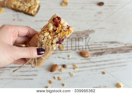 Cereal Granola Bar With Nuts, Fruit And Berries On Wooden Table Background. Healthy Sweet Dessert Sn