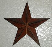 Picture of a rustic looking star on the wall poster