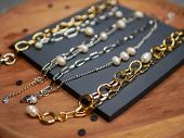 Gold chains. Valentines Day. A precious gift from your beloved on Valentines Day. valuable jewelry. Purchases of precious metals. Flat lay. poster