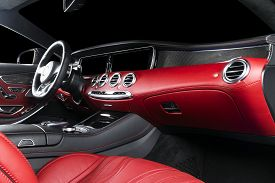 Red Luxury Modern Car Interior With Steering Wheel, Shift Lever And Dashboard. Clipping Path. Detail