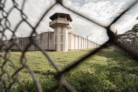 Prison With Iron Fences.prison Or Jail Is A Building Where People Are Forced To Live If Their Freedo