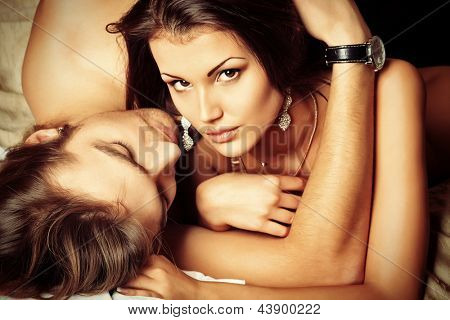 Sexy young couple playing in love games in a bedroom.