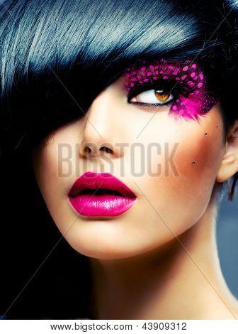 Fashion Brunette Model Portrait. Hairstyle. Haircut. Professional Makeup. False Eyelashes. Purple Make-up
