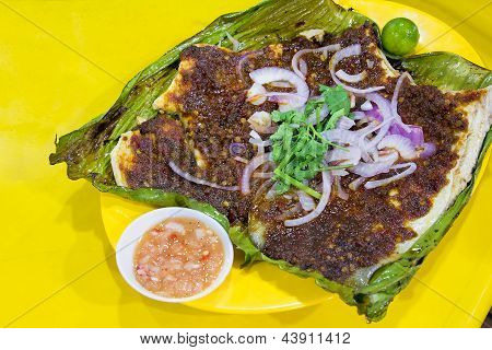 Stingray Fish with Sambal Chili Paste Sauce with Chopped Onions Cilantro and Fermented Shrimp Dipping Sauce poster