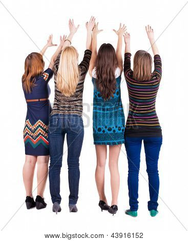 back view of group of young women. girlfriends together. Rear view people collection.  backside view of person. four girls happily pull your hands up. Isolated over white