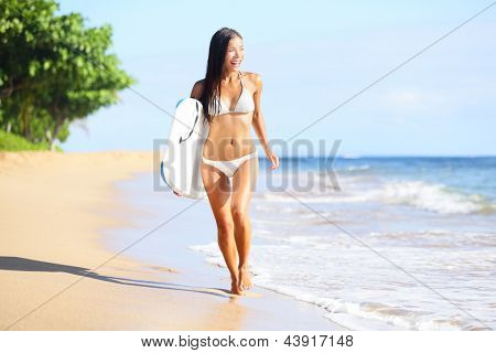 Beach woman fun with body surfboard. Happy beautiful bikini model running on beach looking at the sea on summer vacation holidays. Mixed race Asian / Caucasian woman on Kaanapali beach, Maui, Hawaii. poster