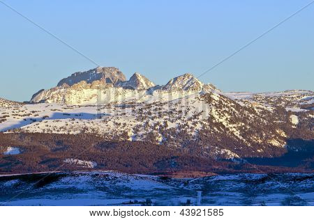 Winter on Mount Moran in the Teton Mountain range as seen from the Idaho side in the Teton Valley. poster