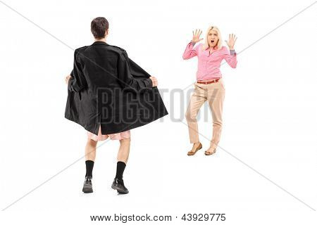 Full length portrait of a flasher scaring a young woman, isolated on white background
