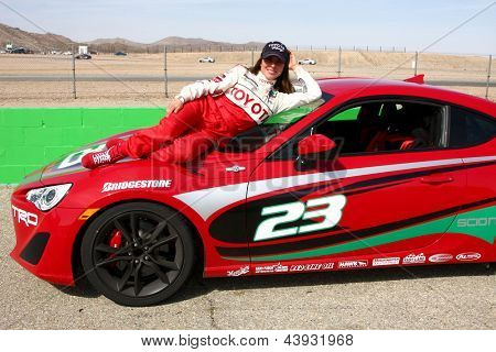 LOS ANGELES - MAR 23:  Kate del Castillo with the Scion FR-S at the 37th Annual Toyota Pro/Celebrity Race training at the Willow Springs International Speedway on March 23, 2013 in Rosamond, CA