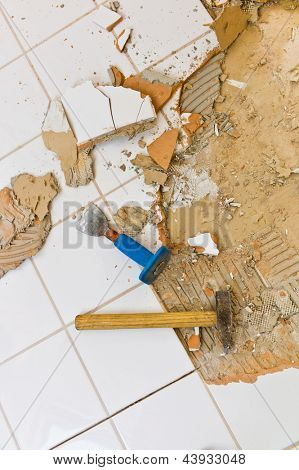 the renovation of a bathroom renovation uind by a construction worker