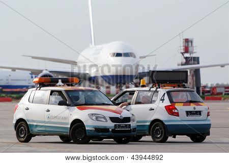 MOSCOW - MAY 22:  Airplane and airdrome car Follow Me at Domodedovo airport, May 22, 2012, Moscow, Russia. Domodedovo airport - largest and most modern airport in Russia.
