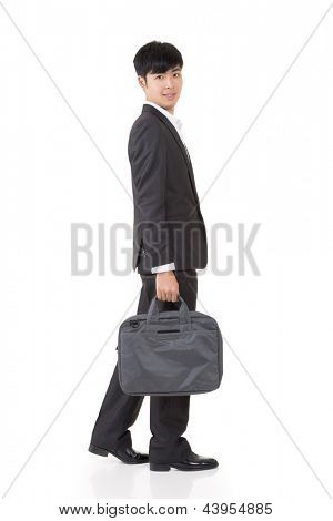 Asian businessman hold briefcase and walk, full length portrait isolated on white background.